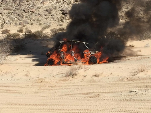 Polaris vehicle on fire in the desert
