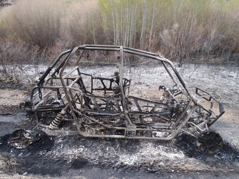 Skeleton on a Polaris vehicle after a fire